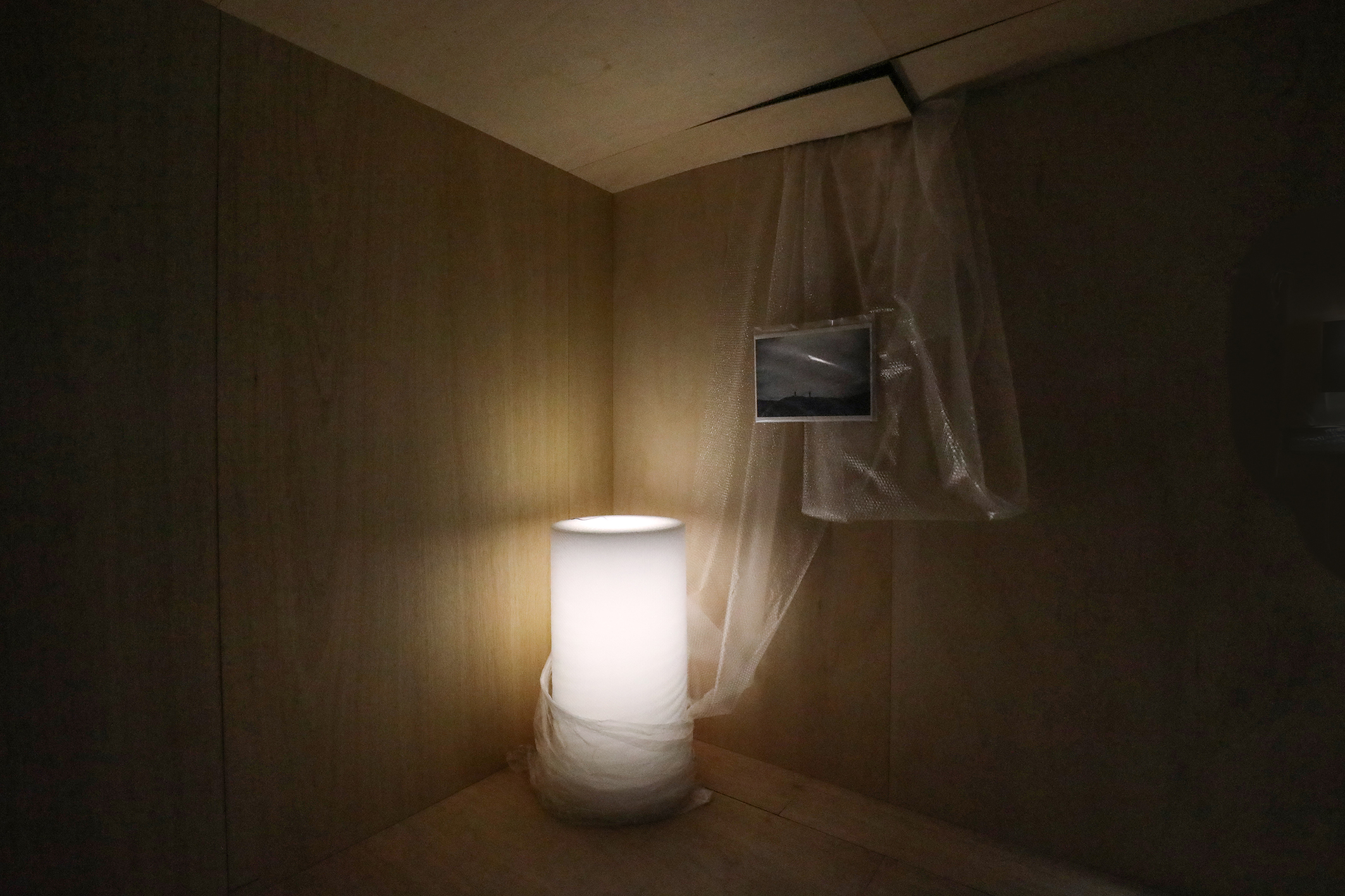 Somewhere Without, Site specific (photography, eraser dust, packaging materials, LED light), Dimensions variable, 2021