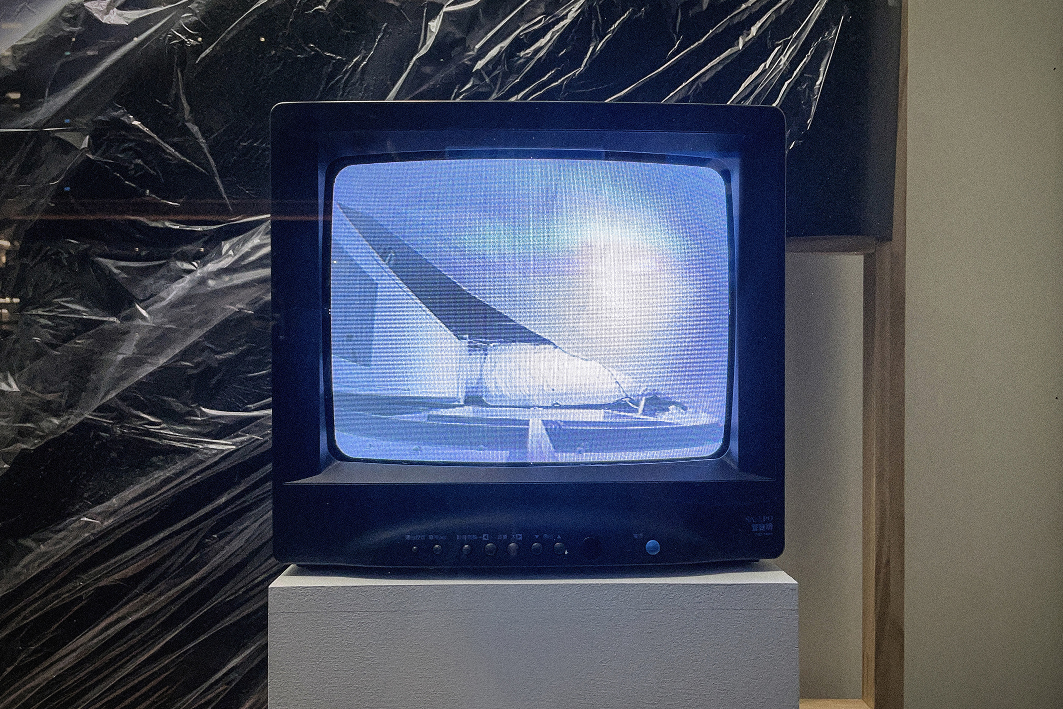 Visible Infinite and Present, Site specific (wooden stand, plastic, TV), Dimensions variable, 2021