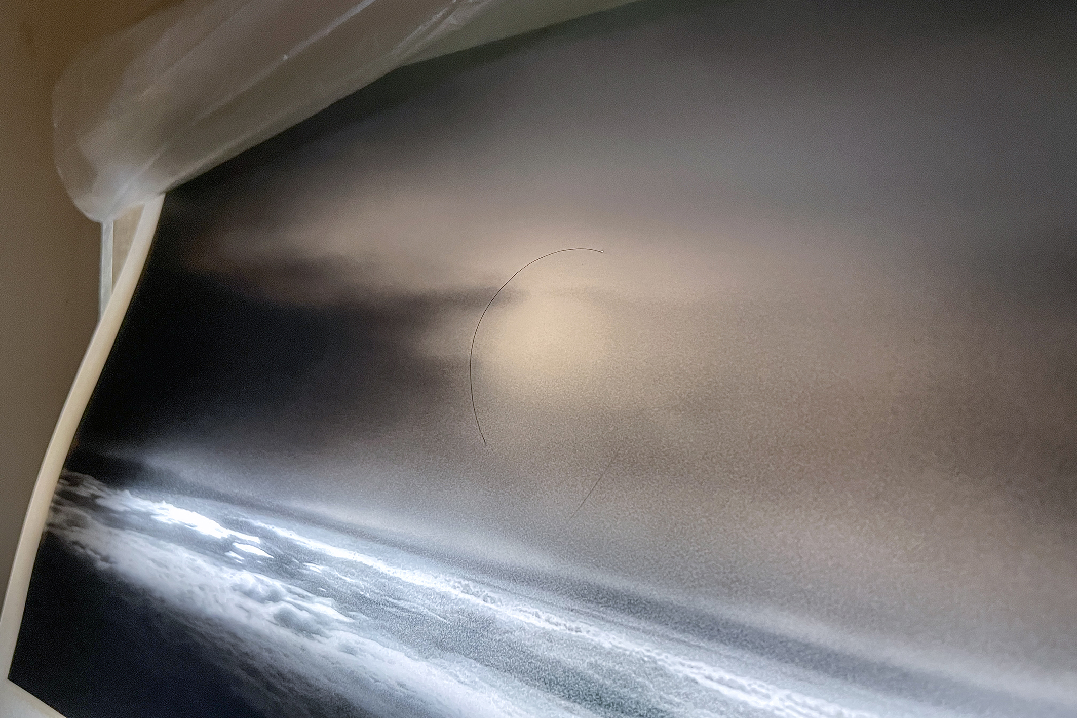 Nowhere I, Mixed media (image, hair, plastic, LED light, carton), 36x54x6cm, 2021
